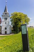 Stock Photo of white church with directions for bicycles
