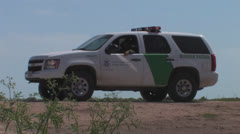 Border Patrol at security fence Stock Footage