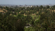 Looking out at city over park with palm trees Stock Footage