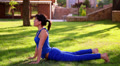 beautiful  girl  doing yoga in the park 1 HD Footage
