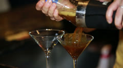 Bartender pouring martinis Stock Footage