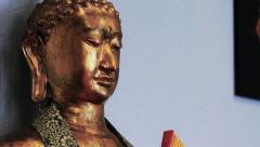 Buddhism: Bronze Buddha Statue - Slow Pan HD Stock Footage