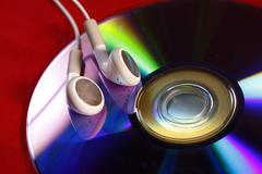 Ear Buds and CD - stock photo