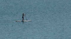 Couple on paddle boards Stock Footage