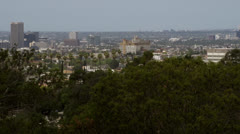 Looking through the trees at Central Los Angeles Stock Footage