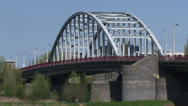 Stock Video Footage of John Frost Bridge. Lower Rhine, Arnhem - low angle, cyclists + traffic