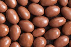 almonds in chocolate - stock photo