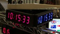 Electronic clock shows time turns at business convention fast motion HD 6573. Stock Footage