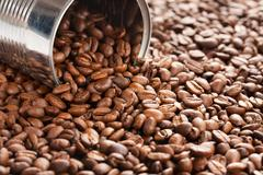 Coffee beans in tin can Stock Photos