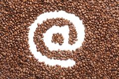 email symbol made from coffee beans - stock photo