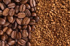 instant coffee powder and coffee beans - stock photo