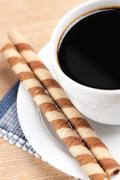 Coffee rolls and cup Stock Photos