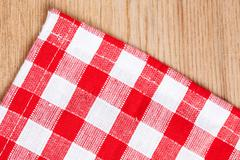 Stock Photo of checkered tablecloth on wooden table