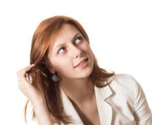Girl straightens her hair and looking at the top Stock Photos