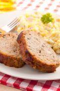 Baked meatloaf with potato salad Stock Photos