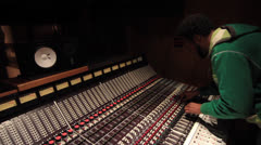 Black engineer mixing on Recording Studio board - Ew 040413 13 Stock Footage