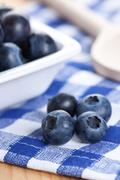 Stock Photo of blueberries on checkered tablecloth