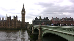 Westminster bridge angled shot showing traffic and Big Ben clock tower - stock footage