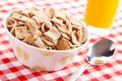 cinnamon cereal in bowl - stock photo