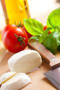 fresh mozzarella with tomato and basil - stock photo