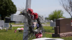 Memorial cross at a cemetery Stock Footage