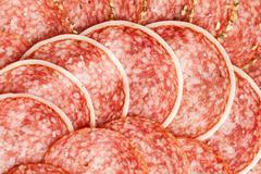 Slices of fresh salami Stock Photos