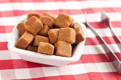 brown cubes of sugar - stock photo
