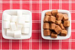 Brown and white cubes of sugar Stock Photos
