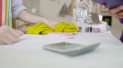 Hands only view of a payment transaction being made over the counter in a shop - stock footage