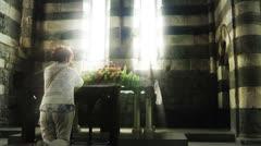 Woman praying in Church of Saint Peter, Portovenere Stock Footage