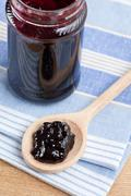 fruity jam in glass jar - stock photo