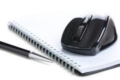 Computer mouse and notebook with pen Stock Photos