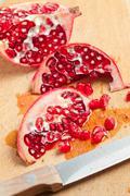 Sliced pomegranate Stock Photos