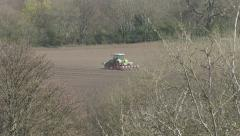 Tractor towing a seed drill. Stock Footage