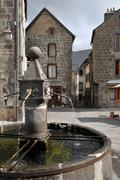 Fountain of Besse en Chandesse in France - stock photo