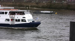 Passenger boat cruising on the river Thames in London - stock footage