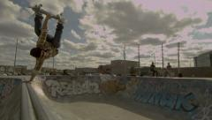 Skateboarding Bowl Handplant on a Graffiti Covered Quarter pipe in a skatepark Stock Footage
