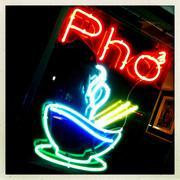 Neon 'pho' sign on restaurant window Stock Photos