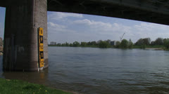 Vertical clearance meter under bridge at River Lower Rhine + tilt up - stock footage