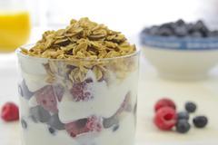 Yogurt with fresh berries and muesli Stock Photos