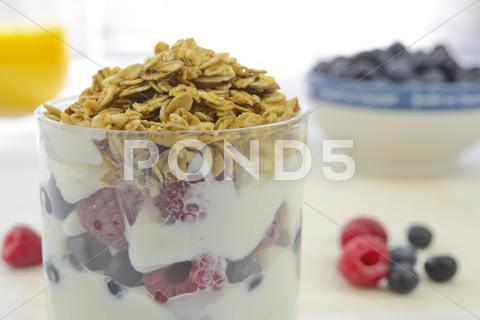 Stock photo of yogurt with fresh berries and muesli