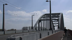 John Frost Bridge, Arnhem - dog walker and traffic Stock Footage