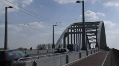 Traffic, cyclist and trolleybus over John Frost Bridge Stock Footage