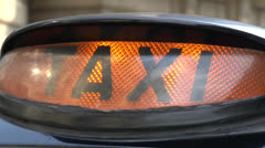 Close up of a lit taxi sign on a London black taxi. Stock Footage