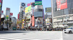 TOKYO - CIRCA MARCH 2013: Pedestrians cross Tokyo's famed Shibuya crossing.  - stock footage