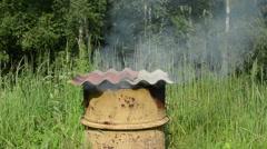 Smoke rise smoke house rusty barrel asbestine slate roof Stock Footage