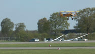 Stock Video Footage of Historic military biplane boeing stearman  touch down
