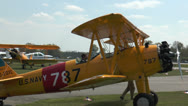 Stock Video Footage of Historic military biplane boeing stearman turning on grass