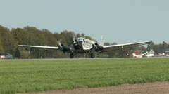 Historic military airplane ju 52 taking off closeup Stock Footage