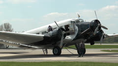 Historic military airplane ju 52 refueling Stock Footage